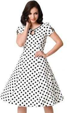 白色和黑色点帽袖摆动连衣裙
