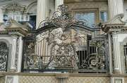 Steel fence with wought steel decoration