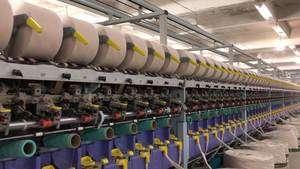 18年代中国高档梯形纱手编纯棉纱针织纱生产企业