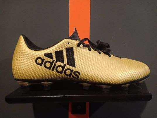 Football shoes X 17.4 FxG - tactile gold matallic/ core black/ solar red